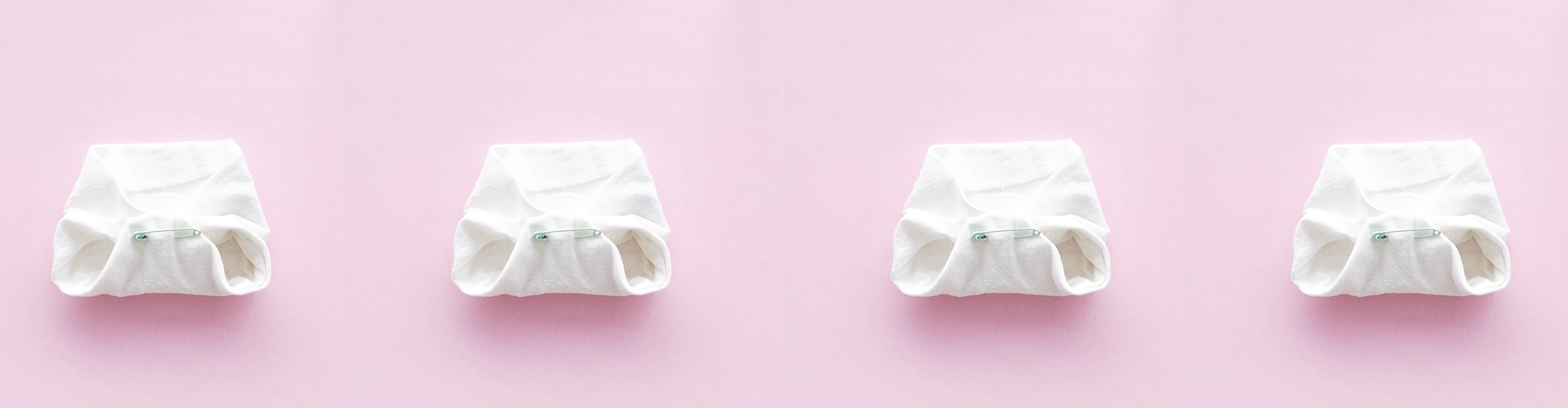cloth nappies with pink background - How often should a newborn poo? An update on Sydney