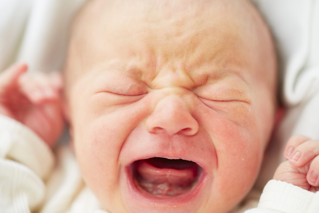 Settling a colicky baby crying newborn