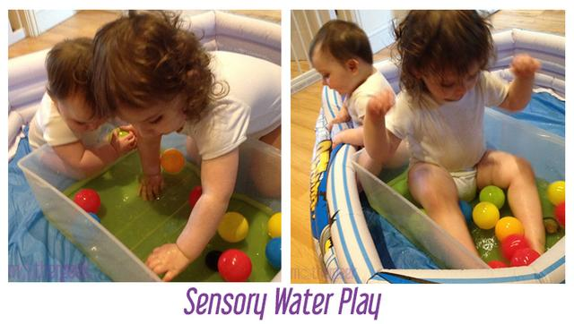 baby girl and toddler boy doing sensory water play, with balls in it