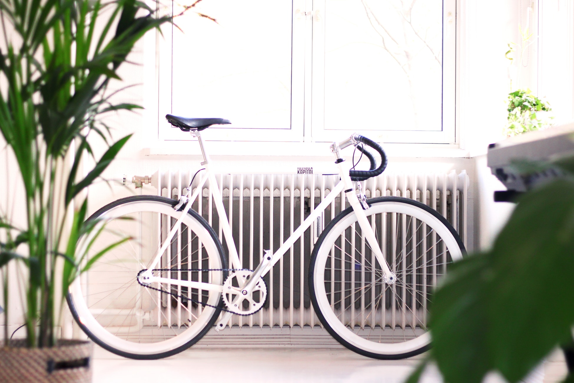 replacing our boiler - radiator with a bike in front of it