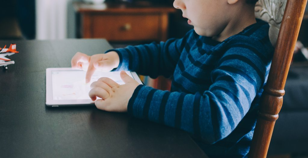 Separate School Holidays - kid on iPad