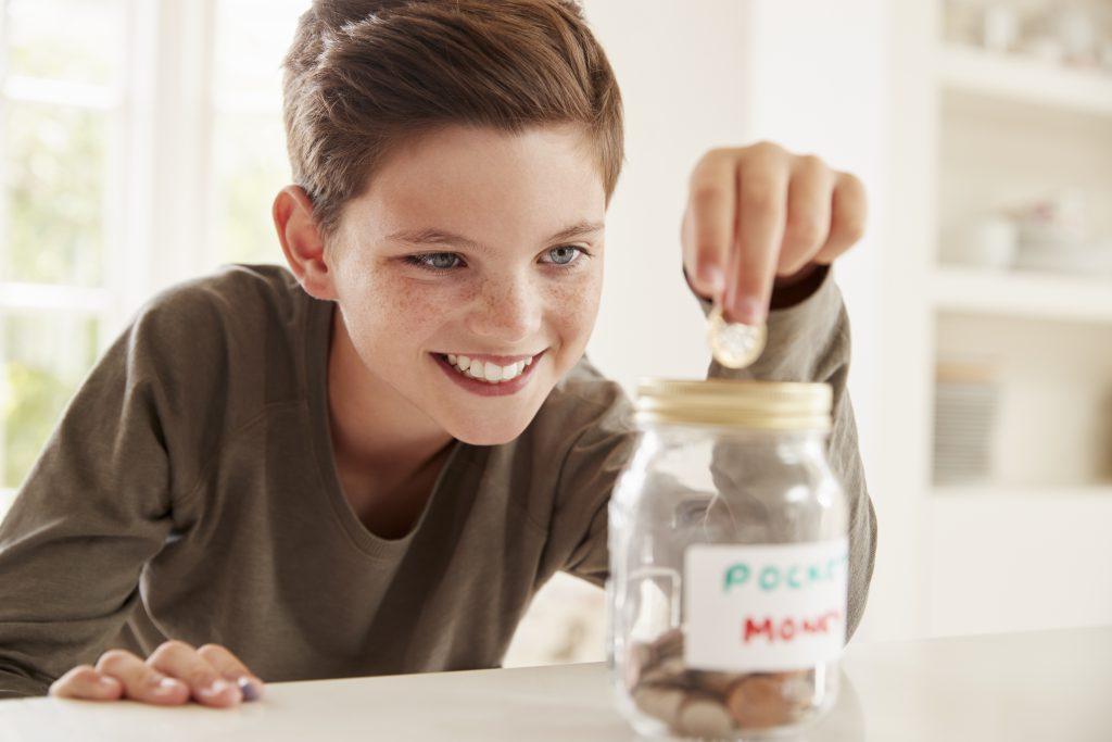 teach kids the value of money boy saving up