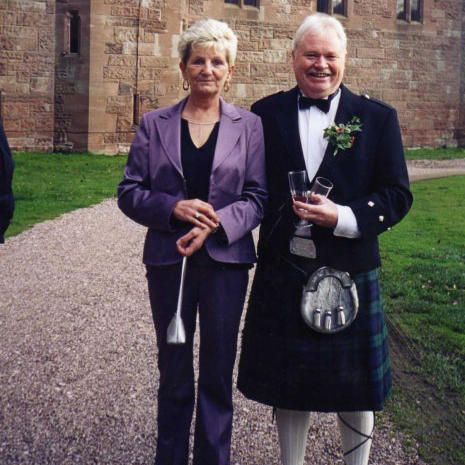 Woman in a purple suit, Man in a kilt. Coping with bereavement