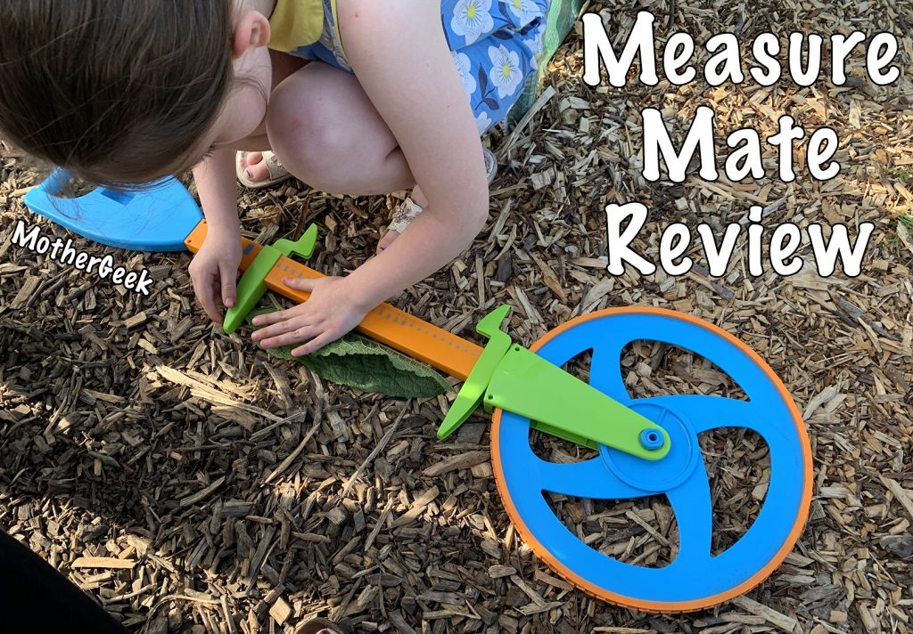 Girl measuring a leaf along the side of the measure mate - for her Measure Mate Review