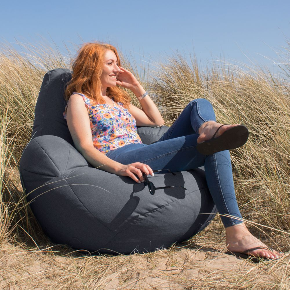 Beanbag Armchair on the grass with a red headed woman sat on it