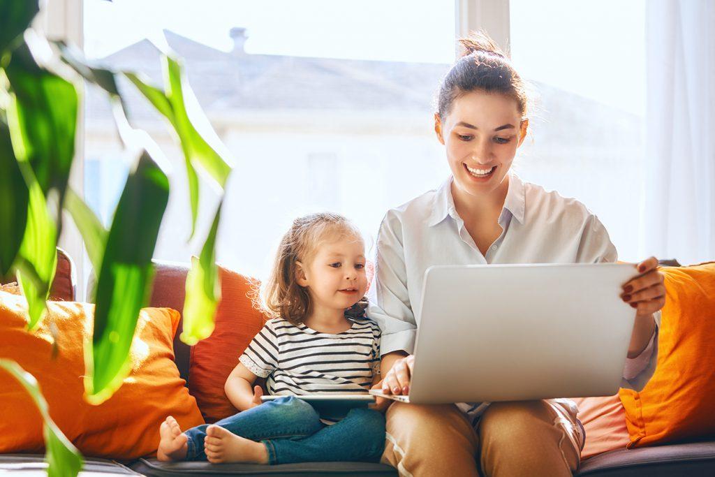 mum and daughter using laptop.