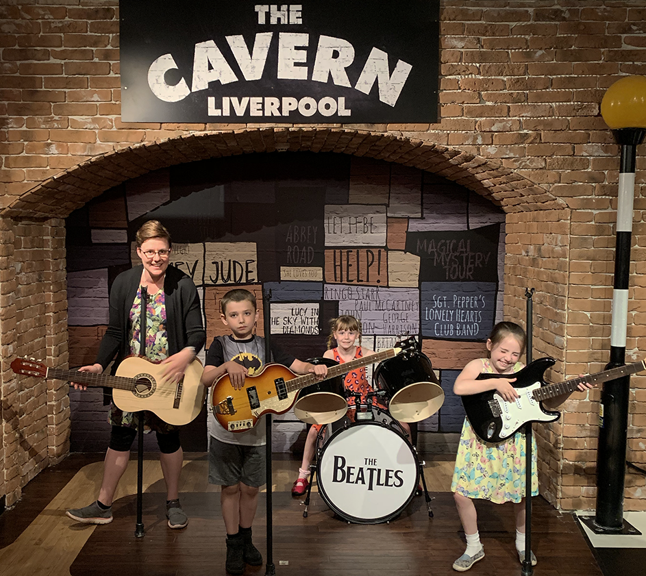 Visiting Madame Tussauds Blackpool with kids - Bex and the kids being The Beatles in The Cavern area