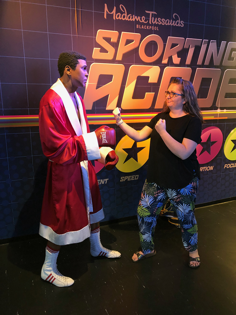Me pretending to box with Muhammad Ali wax figure in - Madame Tussauds Blackpoo