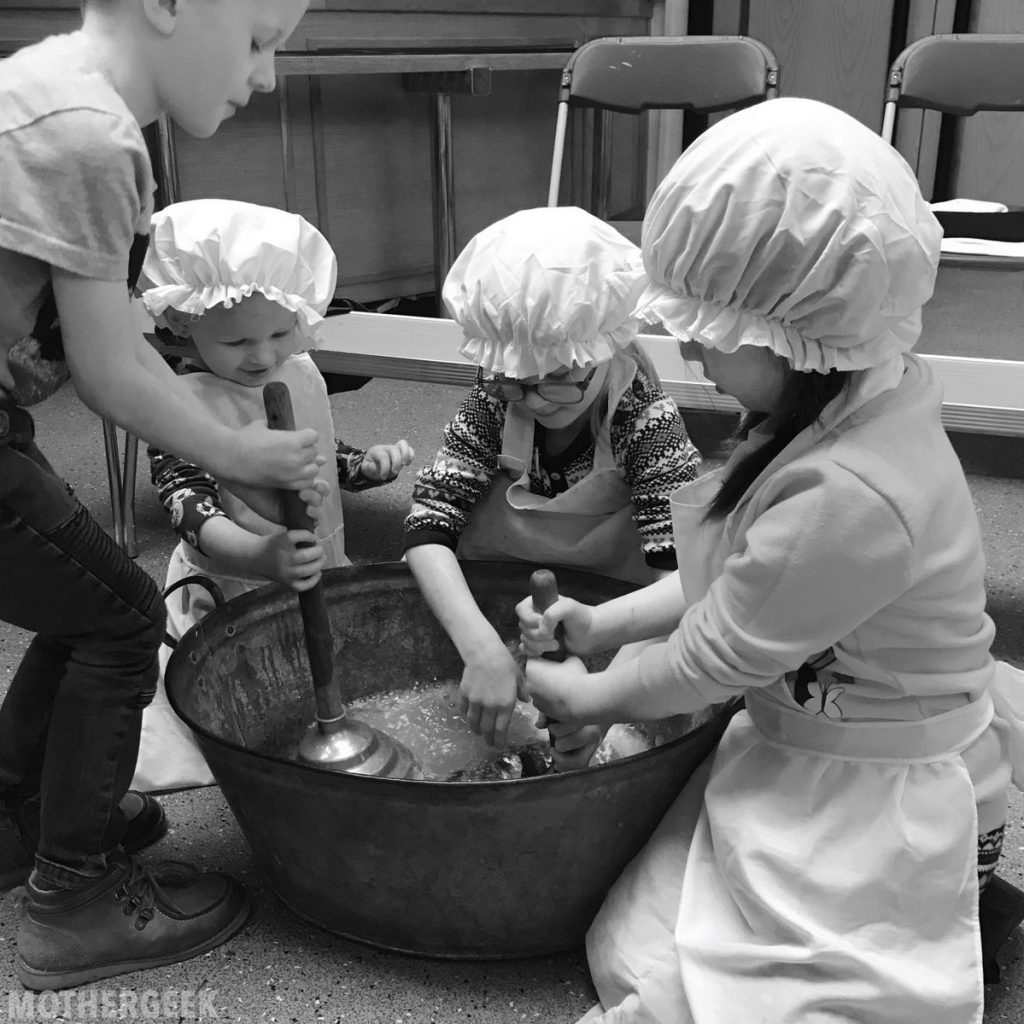 kids washing clothes dressed in victorian clothes - Free Activities In Greater Manchester This Summer