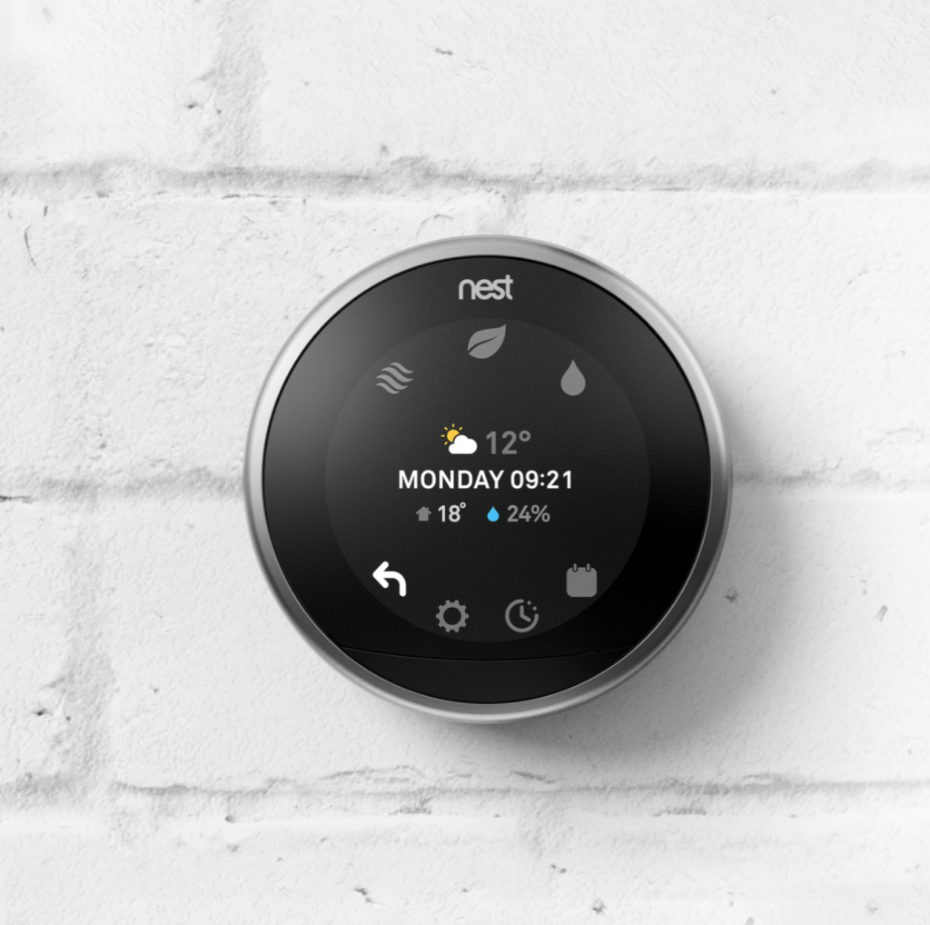 choosing smart devices and gadgets - nest thermostat on the wall