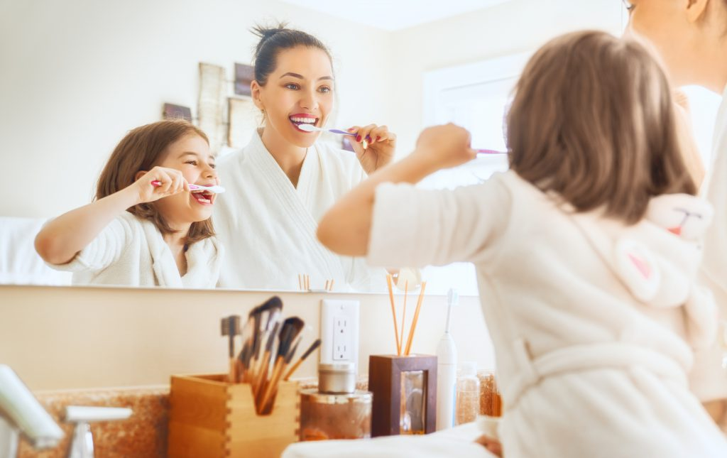 Mum and daughter brushing teeth - Worst Places for the Spread of Bacteria