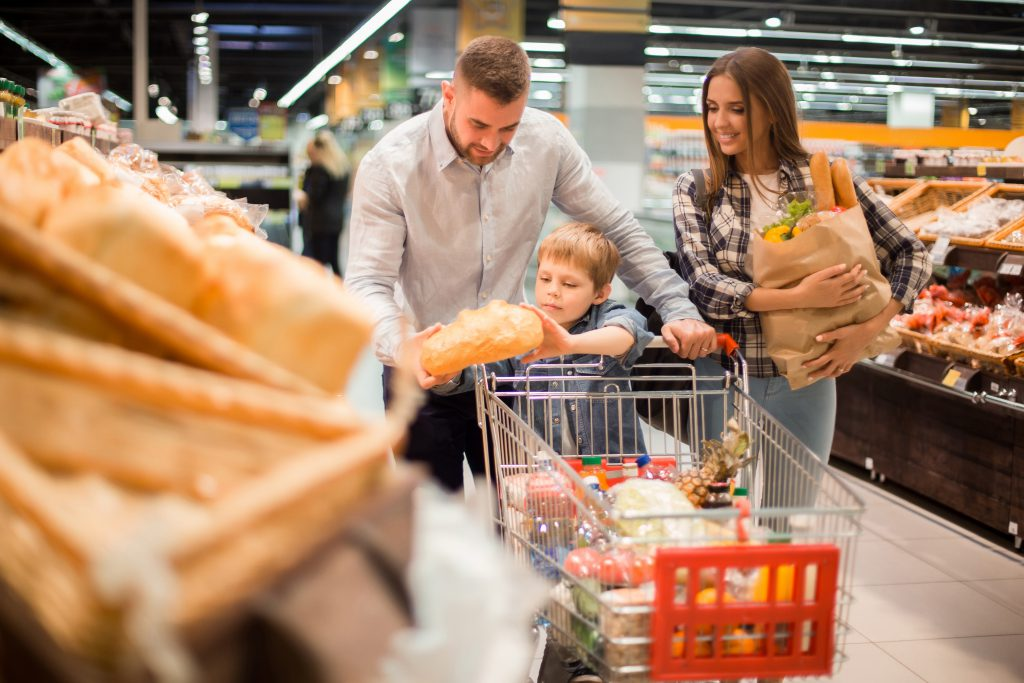 boy handling bread in supermarket - Worst Places for the Spread of Bacteria