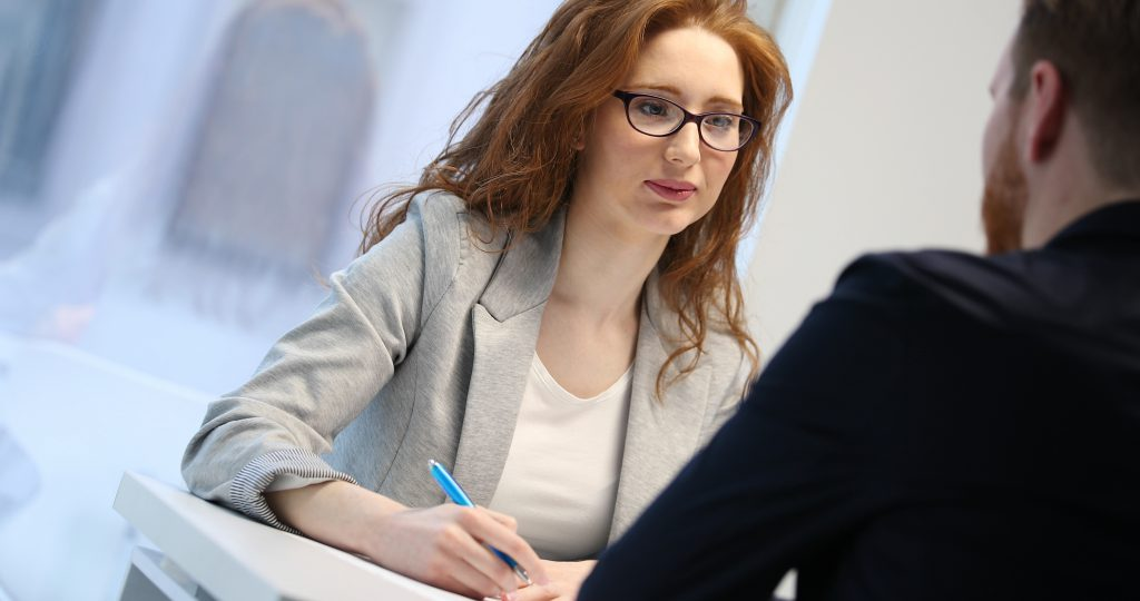 woman carrying out a professional hearing at work
