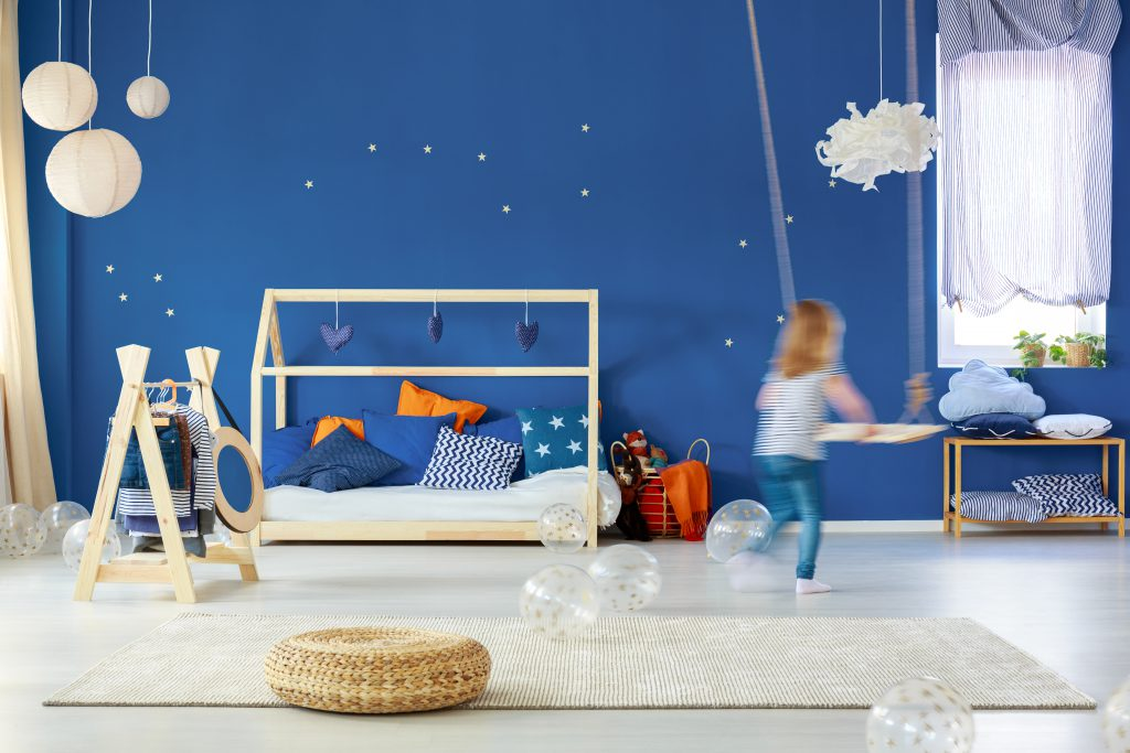 child's bedroom - blue walls, white wood floor - ideas for redecorating a child's bedroom