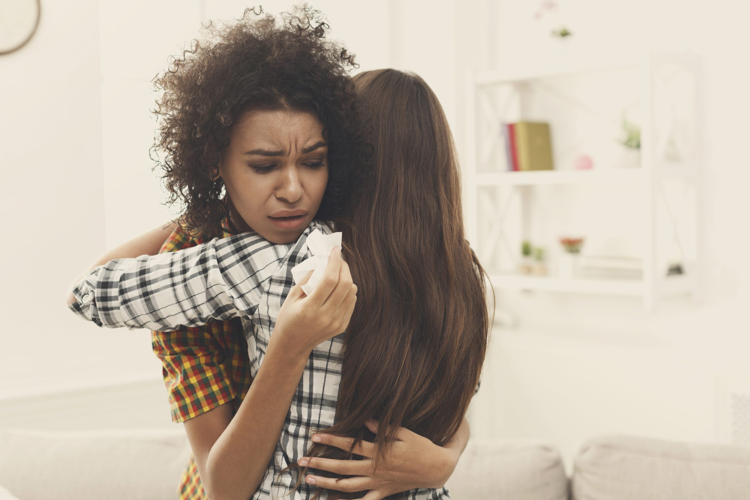 woman hugging teenage girl - following the death of a loved one... how to care for family after experiencing death