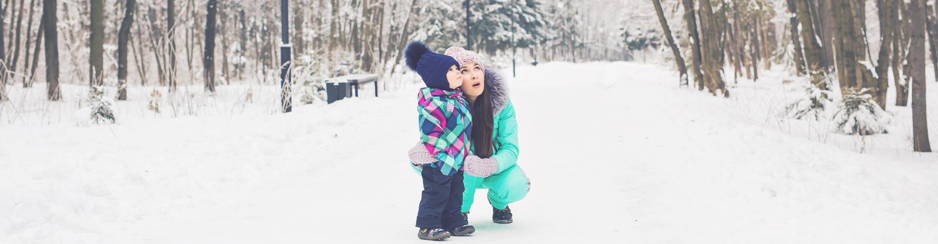 child and mum in snow