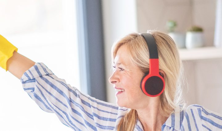 woman wearing headphones listening to my housework Spotify playlist