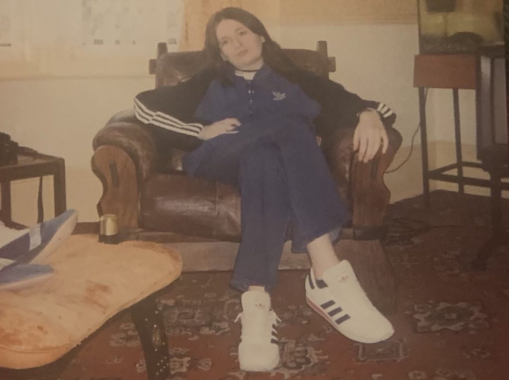 17 year old me, wearing trainers, jeans and an Adidas jacket. What was I doing in Y2K?
