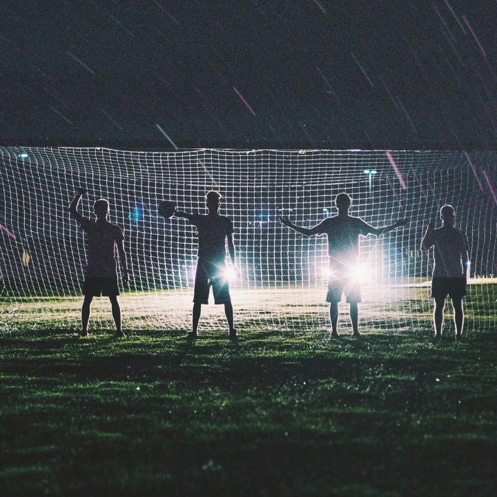Silhouettes of 4 men stood in a football net - who are the world's best footballers