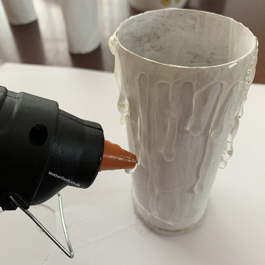 creating the candle drip marks on the tube with a glue gun
