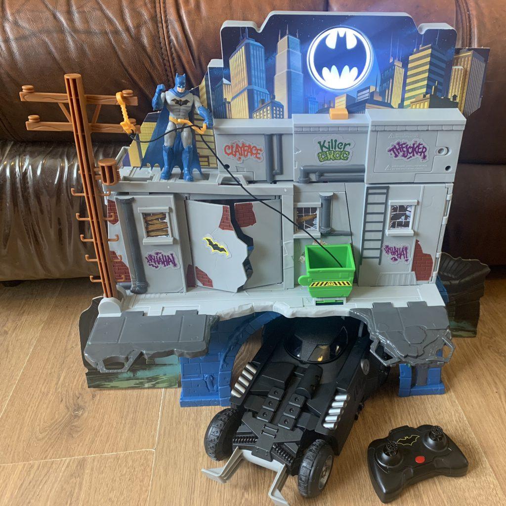 spinmaster batcave and batmobile, with batman stood next to lit bat signal