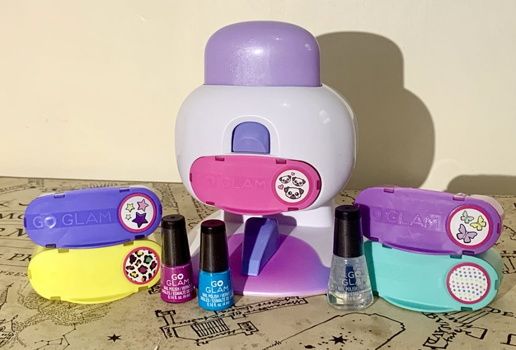 A table with the Go Glam Nail Salon Review equipment laid out on it