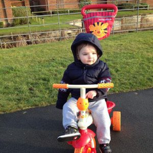 Autistic toddler on a Smart Trike