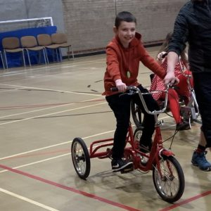 Autistic child riding a trike - Why Trikes Are Great For Those With Disabilities