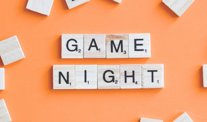 scrabble tiles spelling out games night