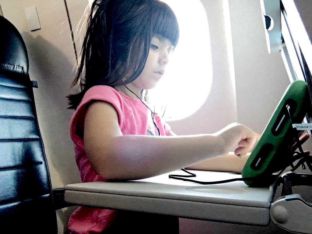 child on plane on our first family holiday abroad