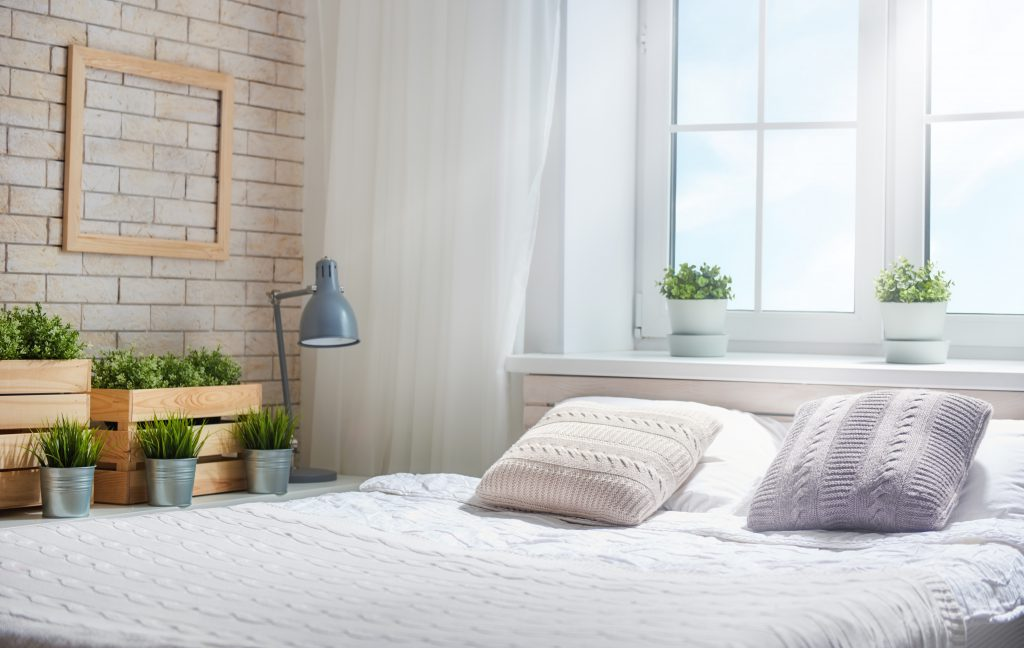 white bedding on a bed to create a beautiful bedroom