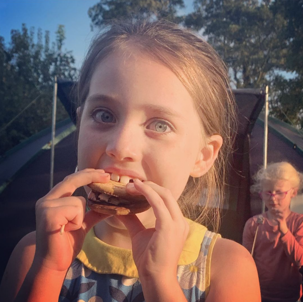 Syd eating S'mores when camping in 2019