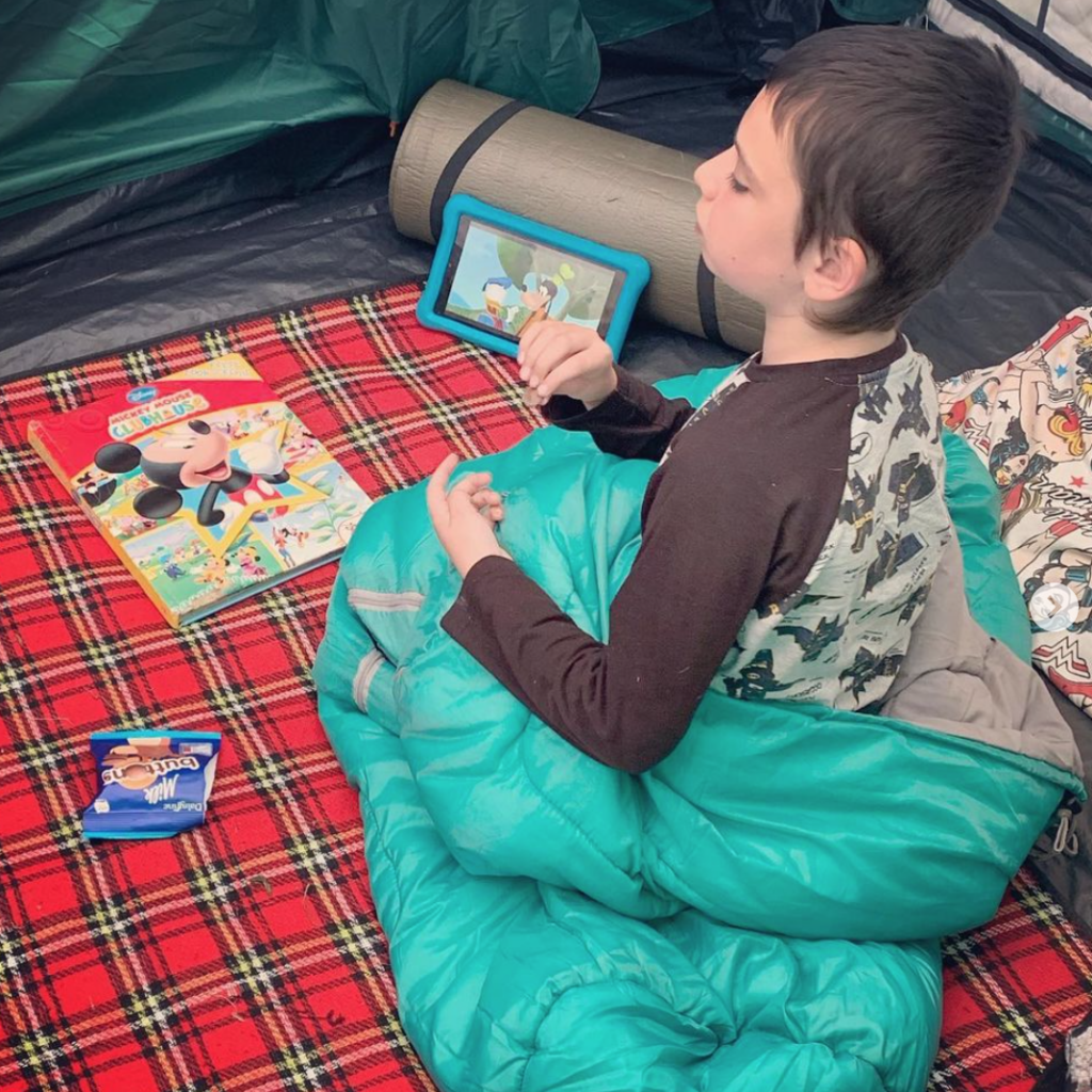Sam in his sleeping bag, when camping. Big little tent festival
