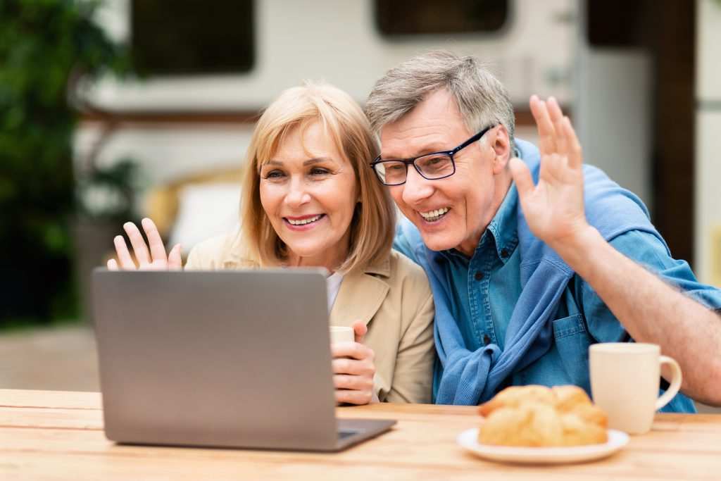 Couple zooming relatives on laptop, after hearing these Happy and Healthy Ageing tips