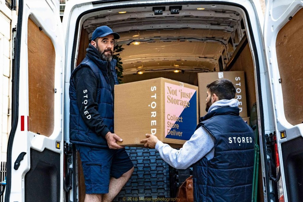 Stored Storage staff members loading up a van. Find out Which storage units are best in London.