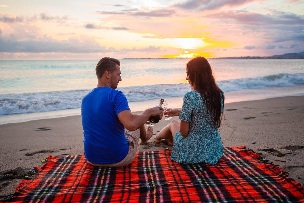 Sunset picnic on the beach - post lockdown date ideas