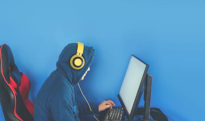 teenage boy gaming at his computer